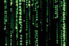 """Bildschirmschoner mit grünen Symbolen auf schwarzem Grund im Stil der Filme der """"Matrix""""-Reihe"""