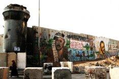 A woman passes the Qalandiya Checkpoint in Ramallah.
