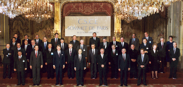 Heads of state or government of CSCE participating States stand for a group photo at the Paris Summit, Palais de l'Elysée, 19 November 1990.